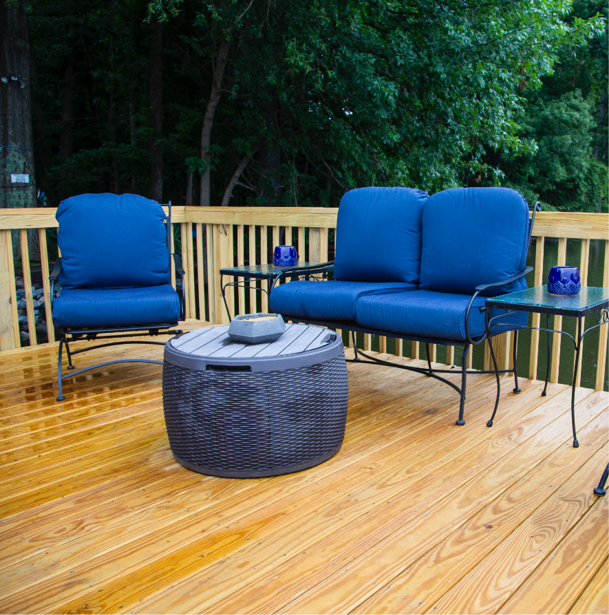 light wood water resistant patio deck with blue furniture