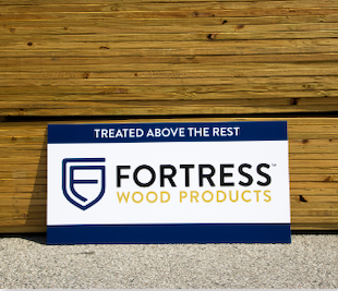 Fortress treated above the rest sight in front of wood stacks