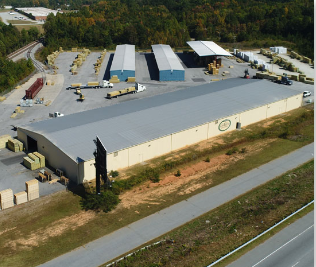view from sky of warehouses and parking lot